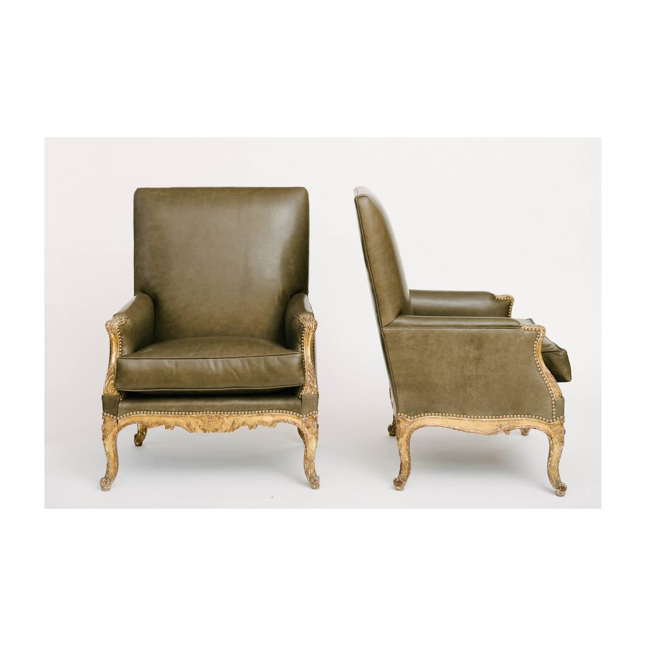 Pair of French Louis XV style giltwood bergères newly upholstered in leather.
