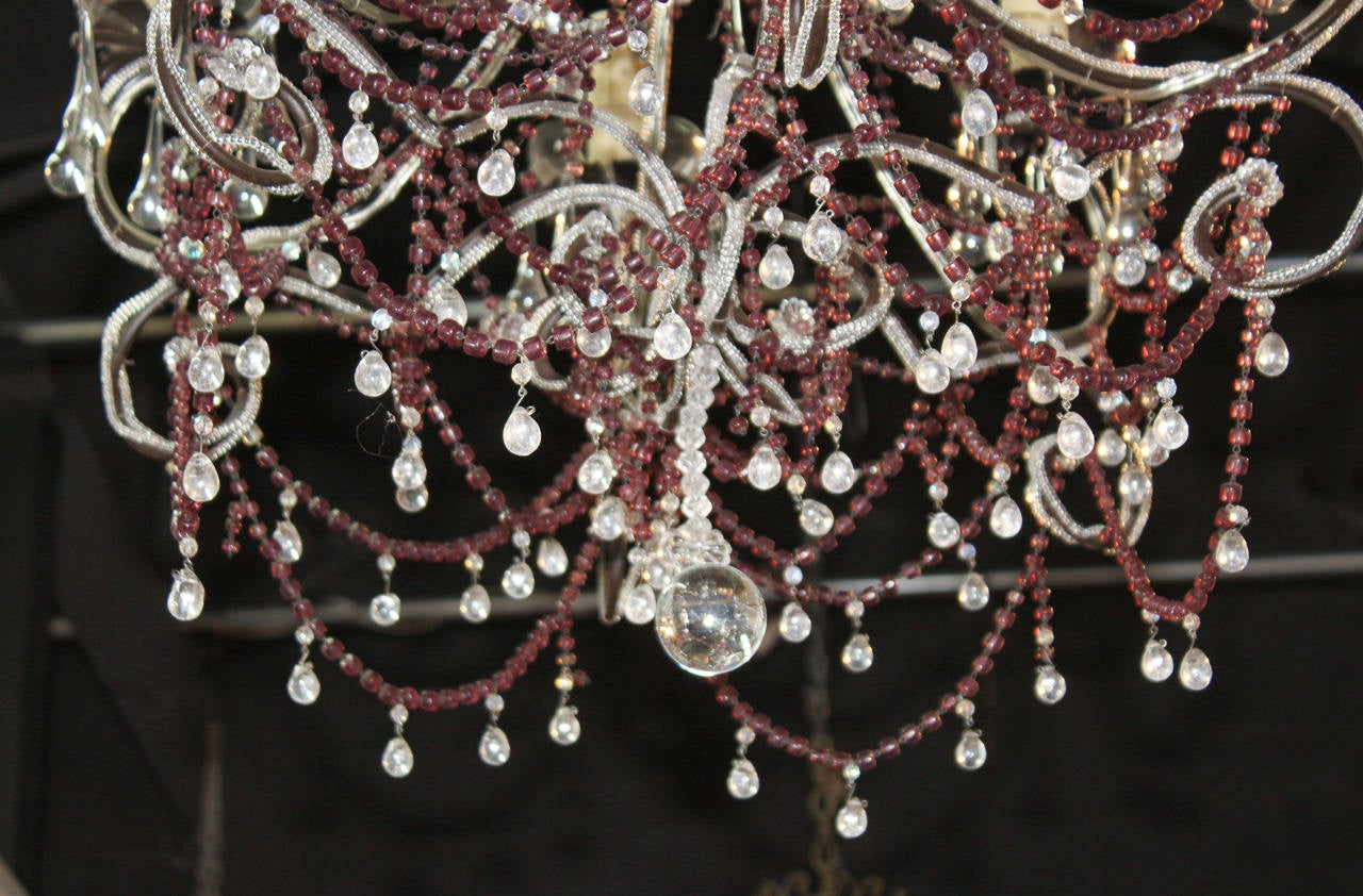 Stunning Italian 6-light beaded amethyst chandelier.  Having long strands of beaded amethyst, scrolling arms, and numerous drop and teardrop prisms.  Wonderful for numerous designs!