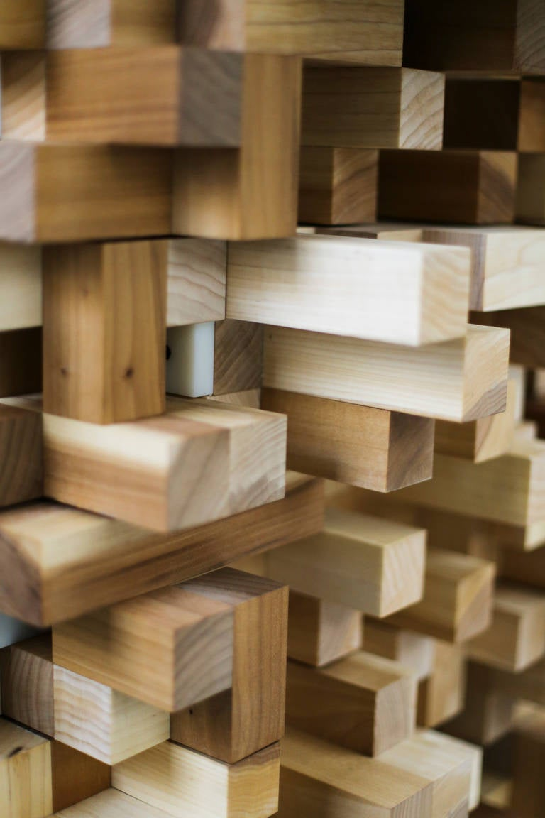 """The """"Diffuser Cabinet"""" appears as a freestanding sculpture, assembled of individual pieces of tulip wood that are altogether irregular. Its unique form is actually shaped by a mathematical calculation that optimizes the acoustic performance of the"""