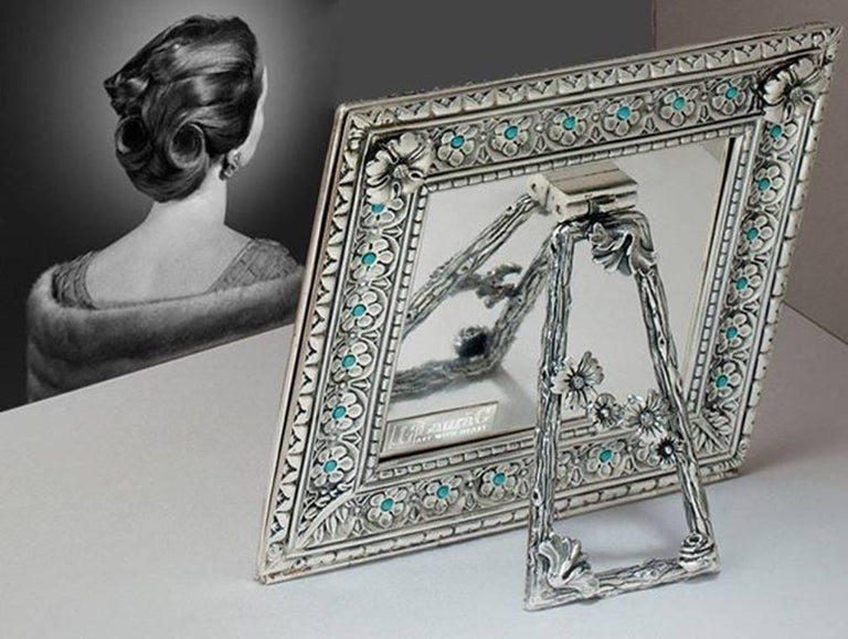 Harmony turquoise is an Arts & Crafts square silver picture frame designed by Laura G for Art with Heart. It is a wonderful lost wax silver model hand chiselled by master craftsmen with a petit fleur design, typical of 16th century Siena