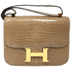 6c51fb3ce503 Hermes Glossy Crocodile Porosus Naturelle Sable and Gold Constance Bag