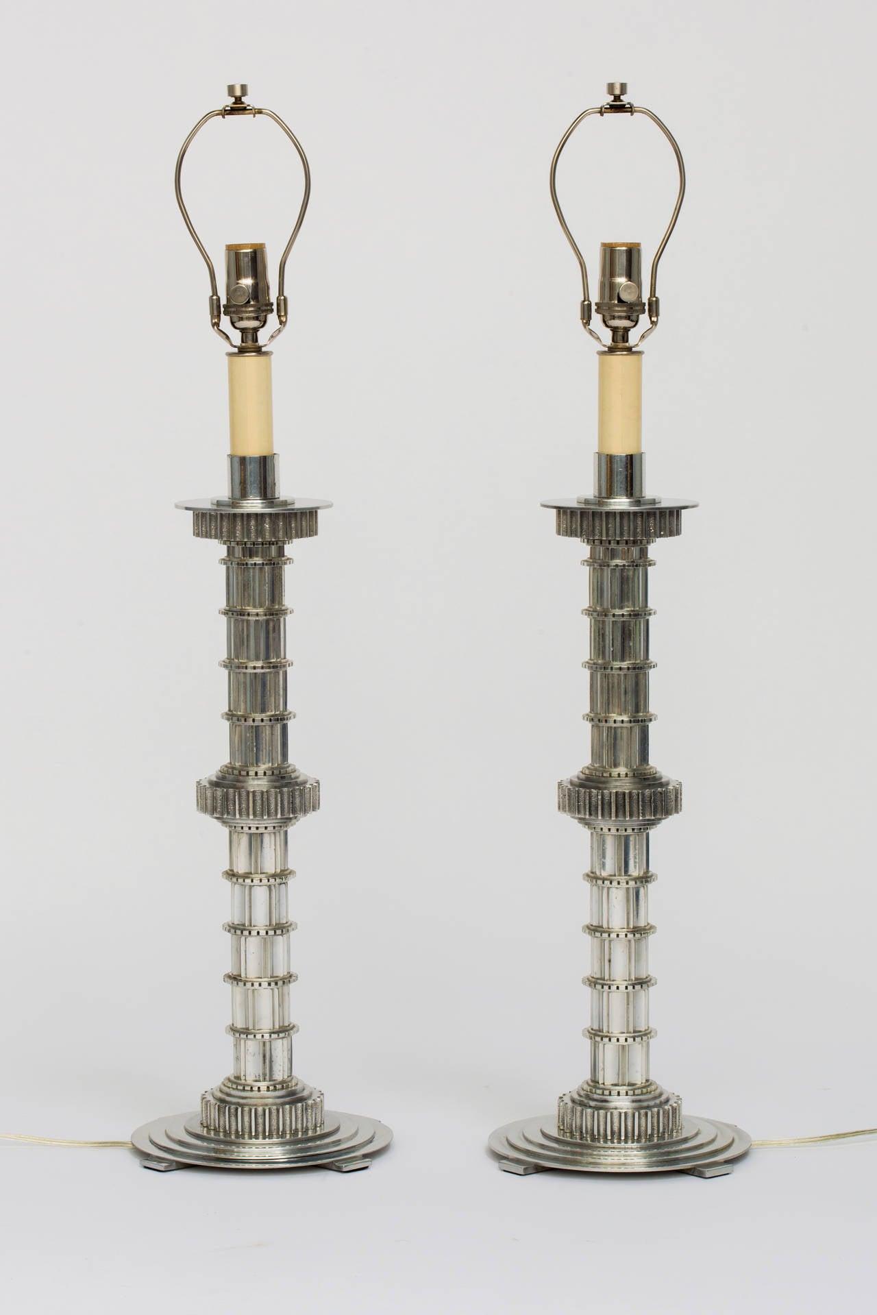 Pair of solid cast aluminum lamps.