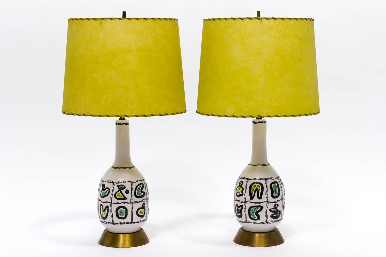 A pair of fun, 1950s hand-painted Italian lamps with original chartreuse shades.
