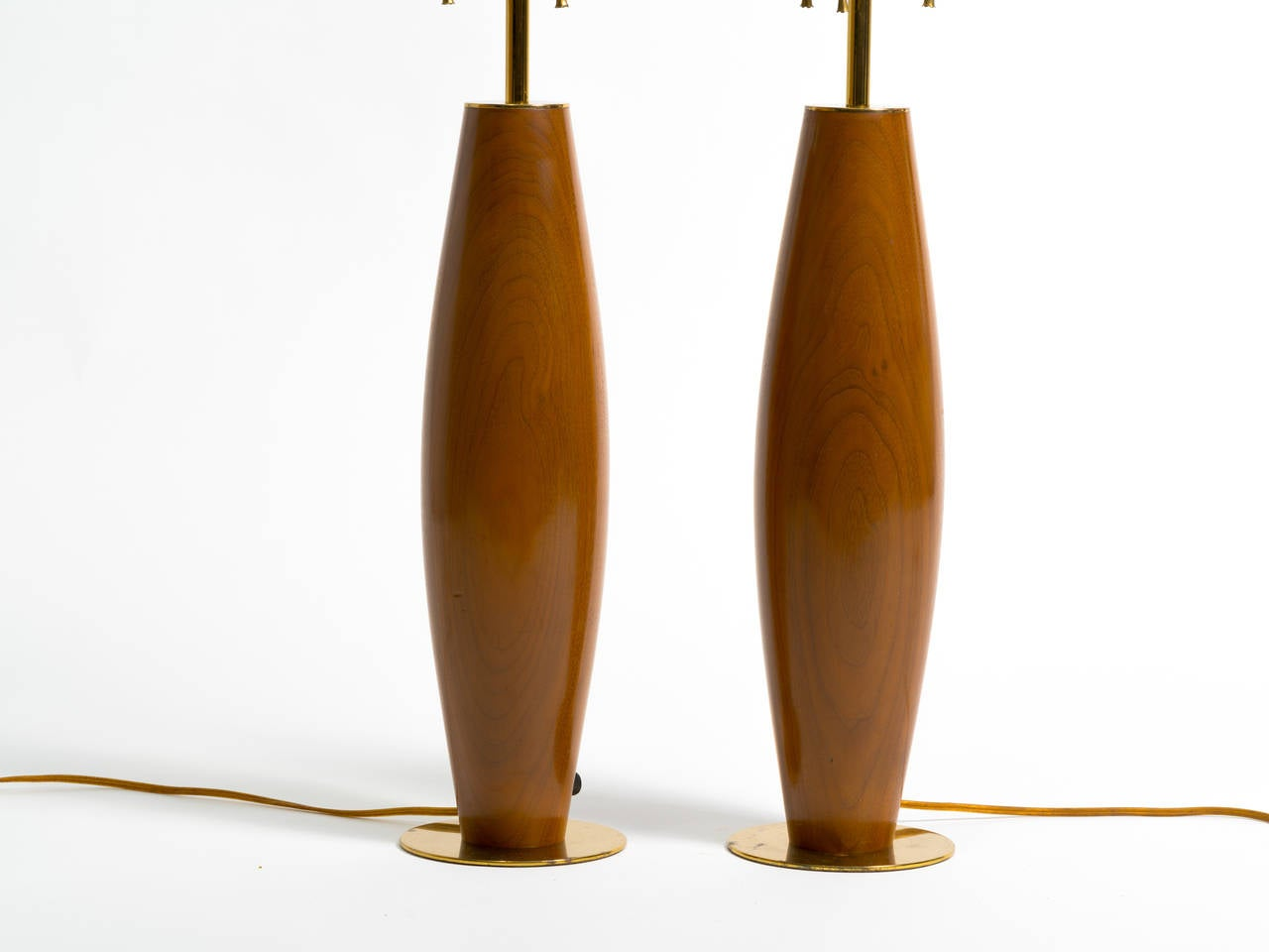 Pair of monumental walnut and brass table lamps.