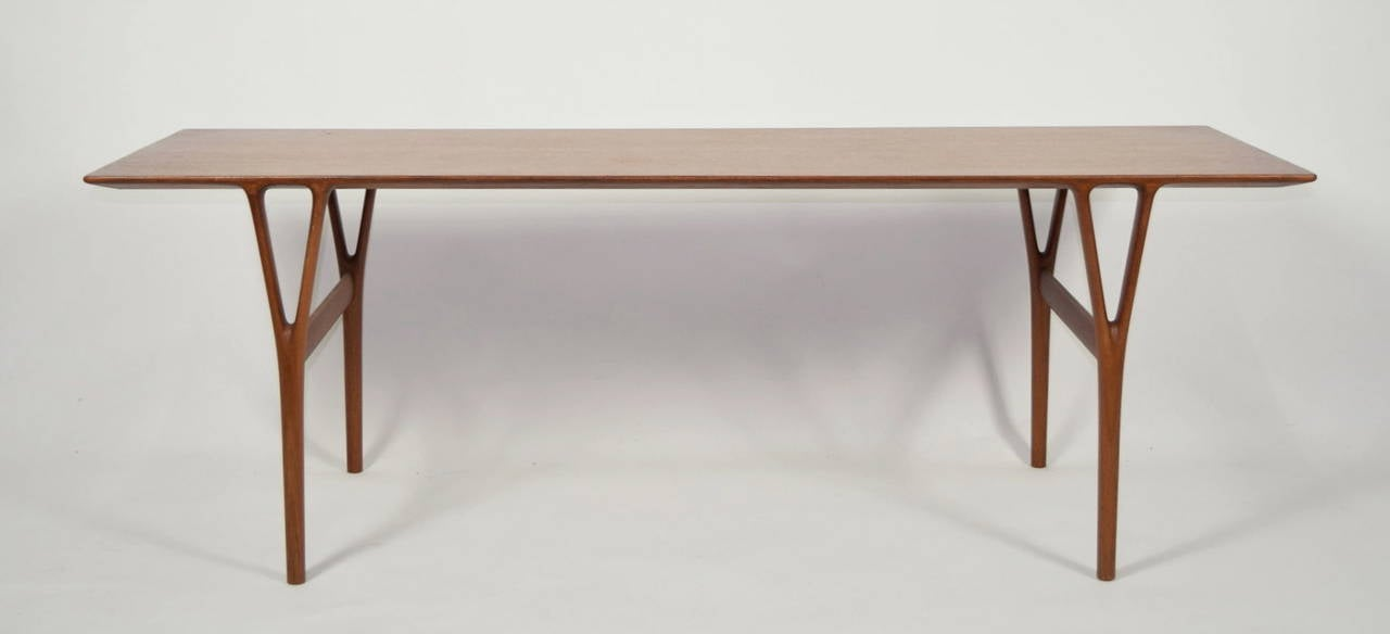 Coffee table model number U55, teak top with solid Y shaped legs, cross bar stretchers. Made by master cabinetmaker Peder Pedersen.