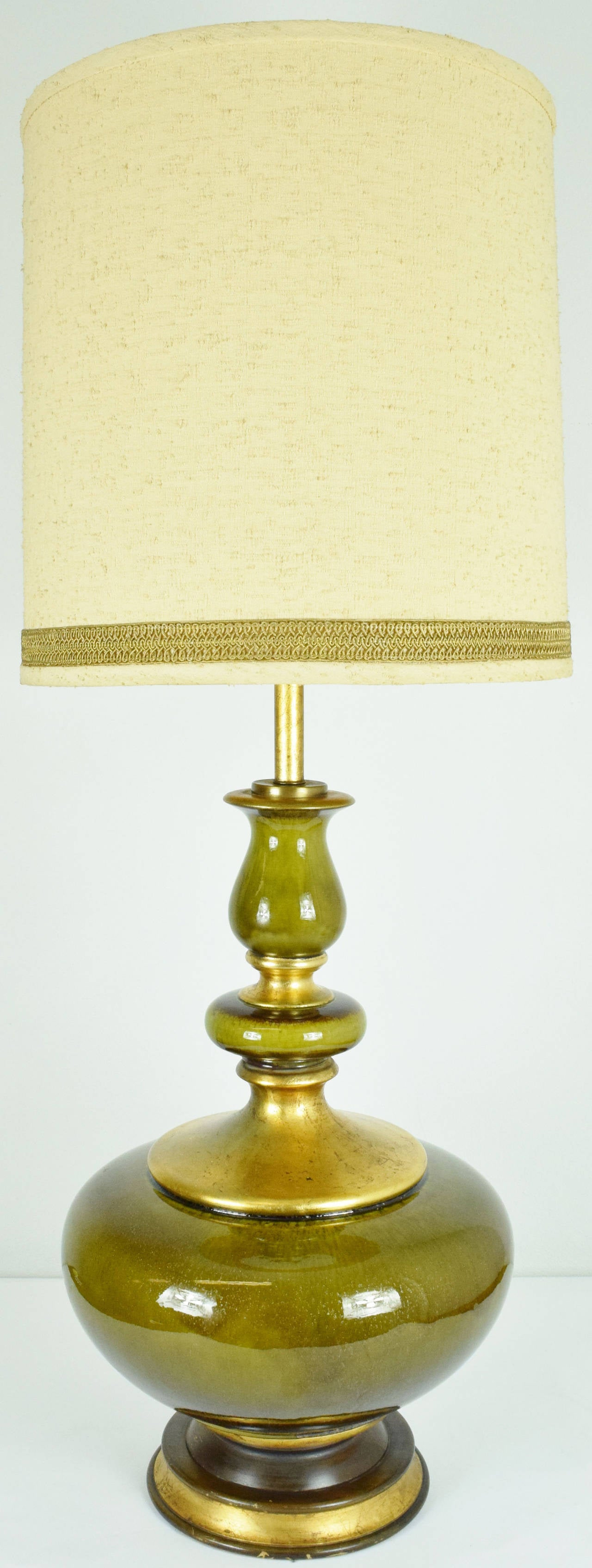 This is a gorgeous lamp in ceramic with beautiful gold flecking. The lamp has the original shade and is 37