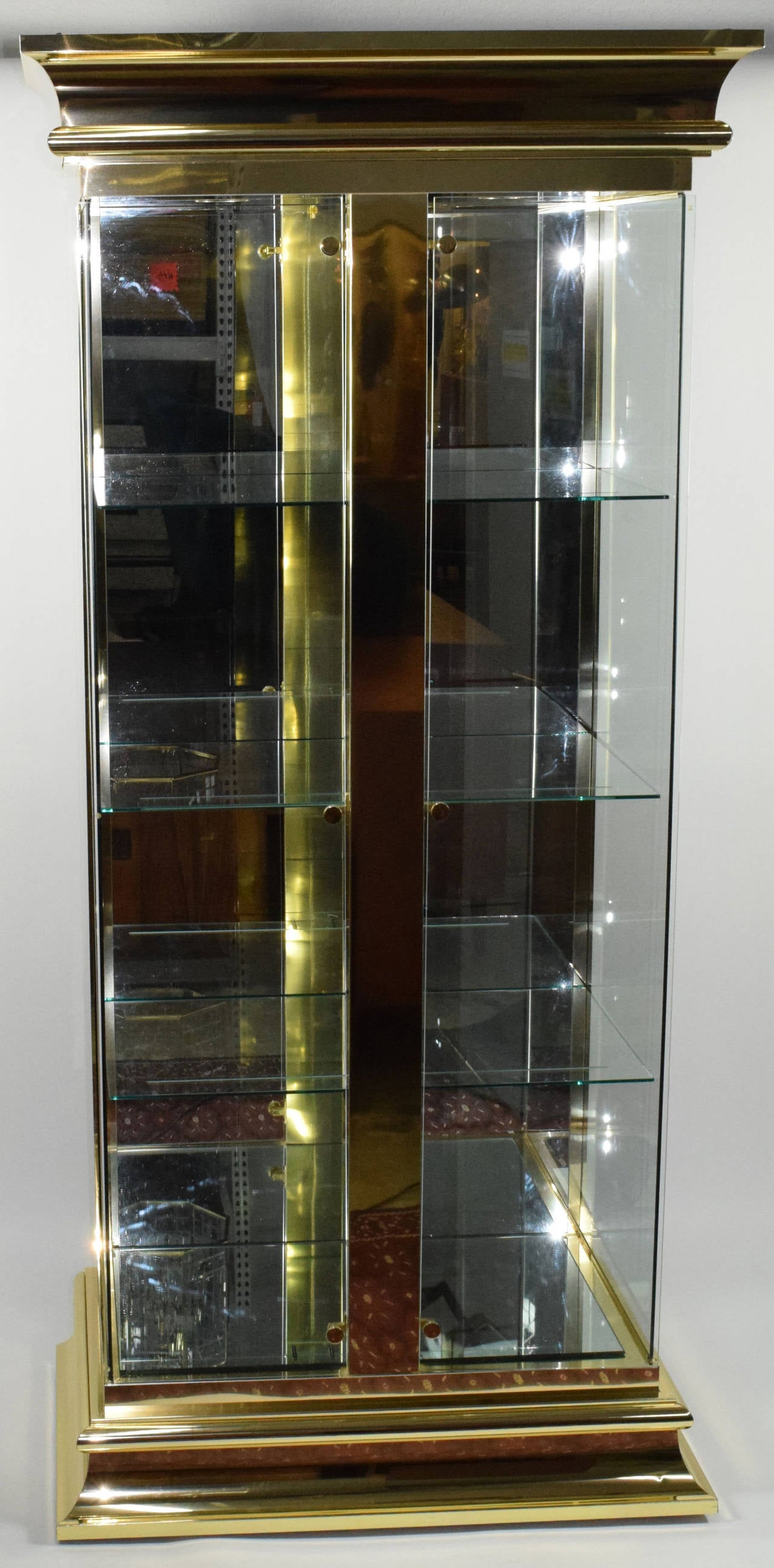 lighted display vitrine cabinet in brass finish attributed to