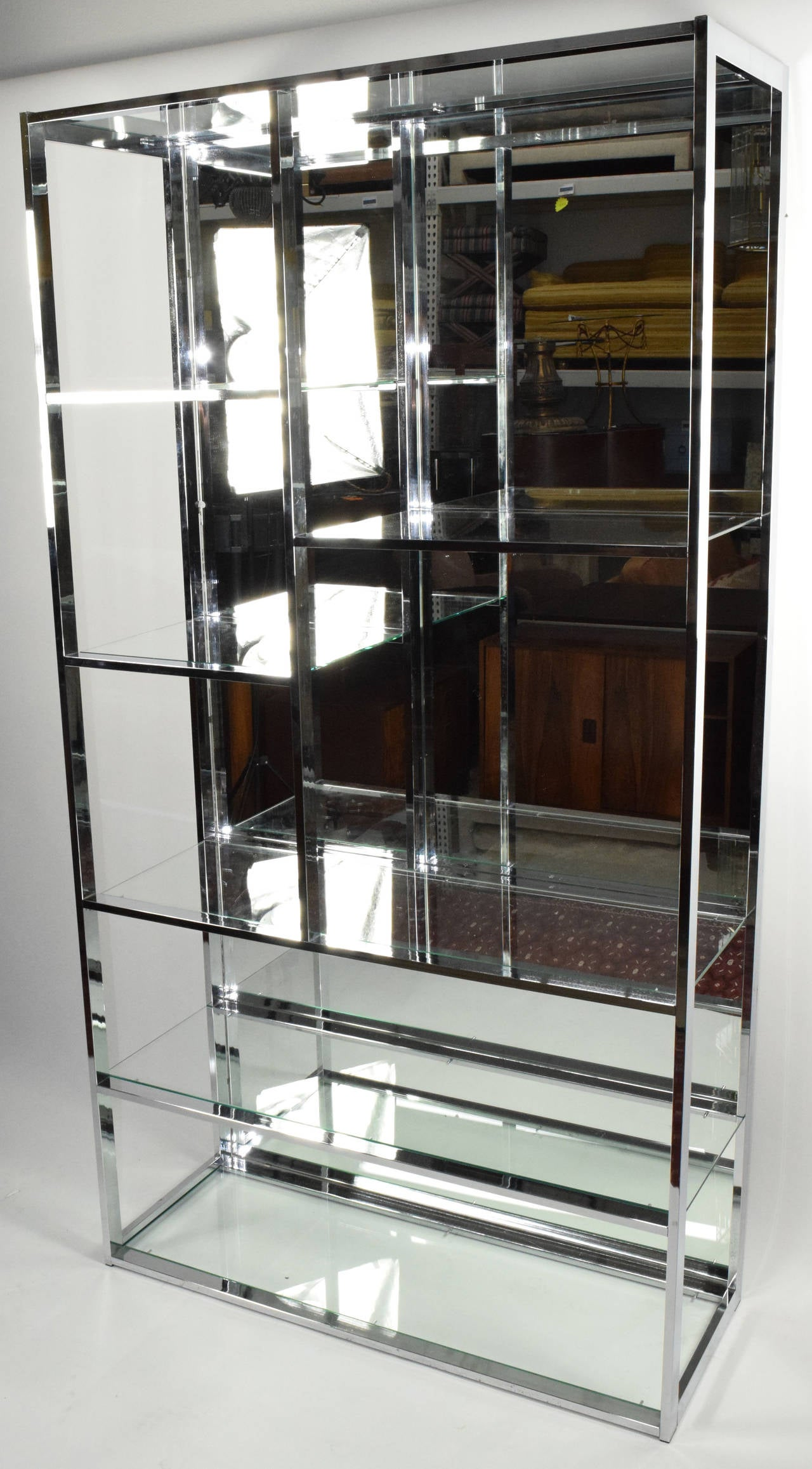 Milo baughman attributed chrome etagere with mirror back for Miroir etagere