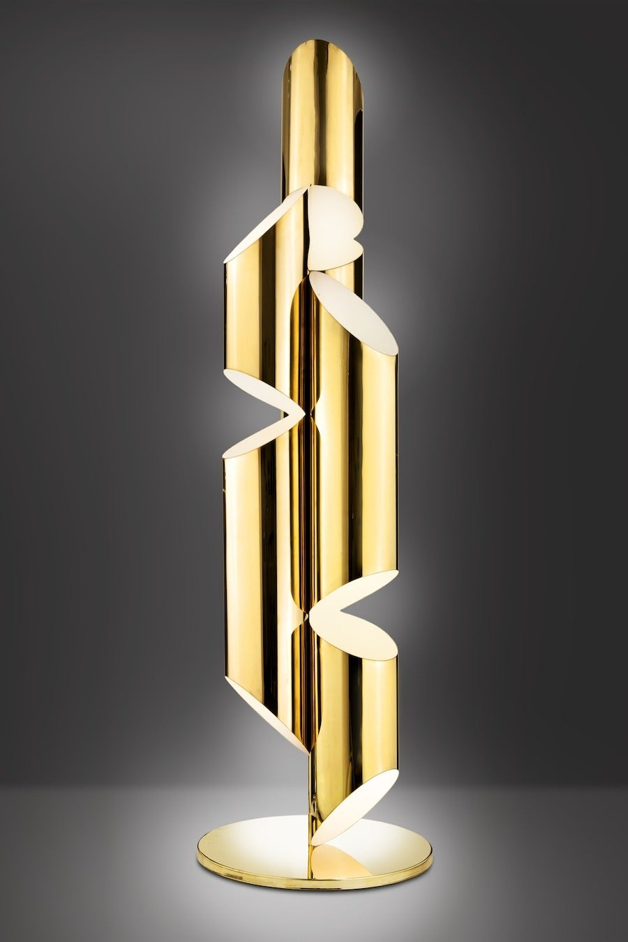Inspired by church organ pipes, this seven-foot floor lamp or sculpture is fabricated from mirror-polished brass. Incandescent light fills each tube and glows out from strategically placed slits creating a warm and inviting Ambience. Designed in