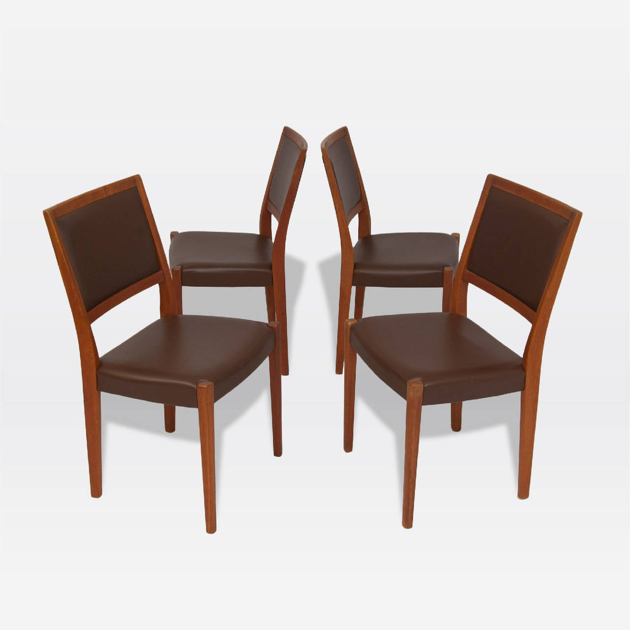 Four teak chairs with vinyl upholstered seats by Svegards Markaryd.