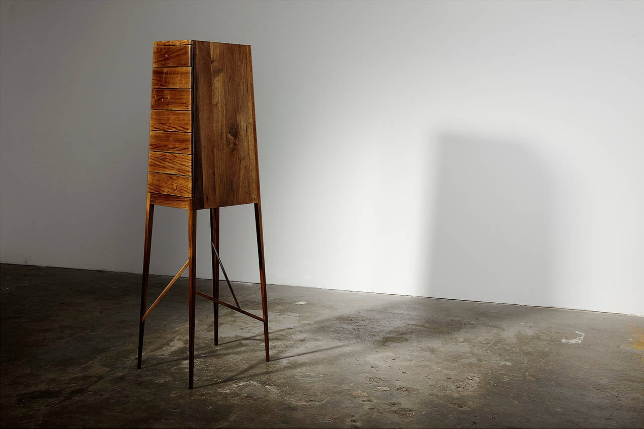 This Charles Wilson piece beautifully integrates a range of colonial period references into a traditional furniture type, a Tall Boy, which also has its origins in the late 17th century. The seven-drawer Tall Boy brings together a love for the