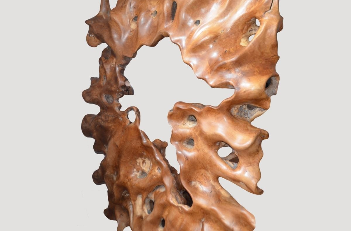 Beautiful hand-carved sculpture from a single reclaimed teak wood root. Beautiful on both sides. Set on a modern black steel base.  Andrianna Shamaris, Inc. The Leader In Modern Organic Design™