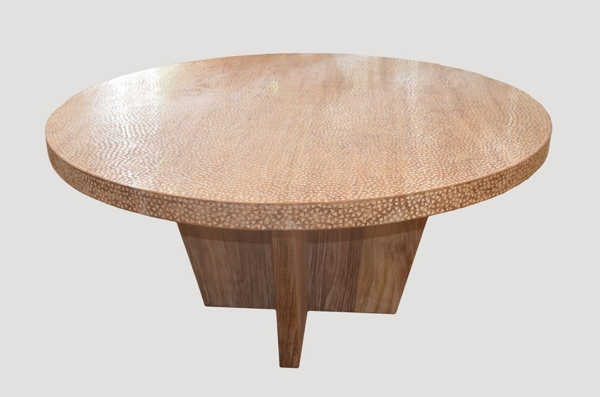 Beautiful hand shell inlay teak dining table. Rests on a modern cross teak base. Custom order with or without shell inlay.   Andrianna Shamaris. The Leader In Modern Organic Design™
