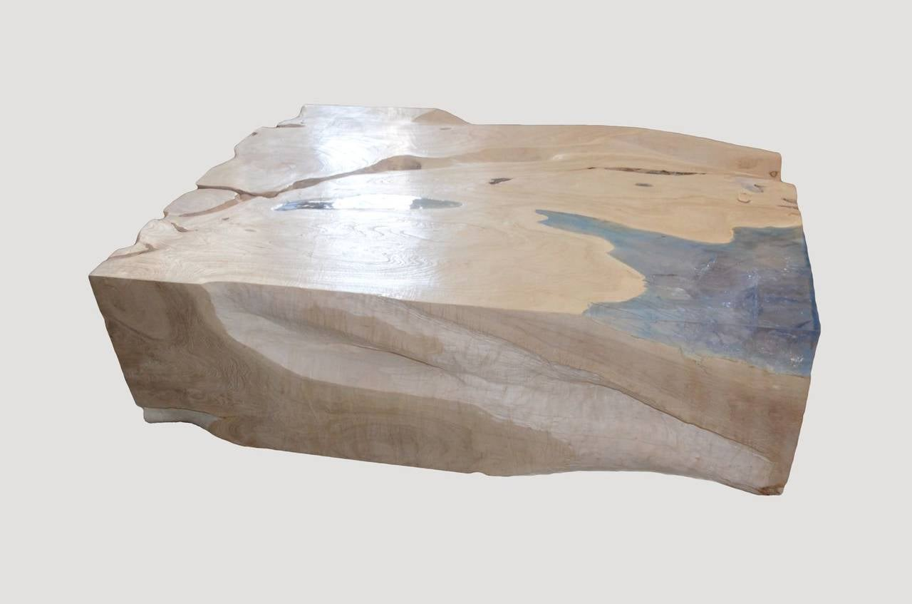 A solid organic teak wood root is bleached and left in the sun for over a year to develop this beautiful finish. Pale blue resin has been added to the natural grooves in the wood.  The St. Barts Collection features an exciting new line of organic