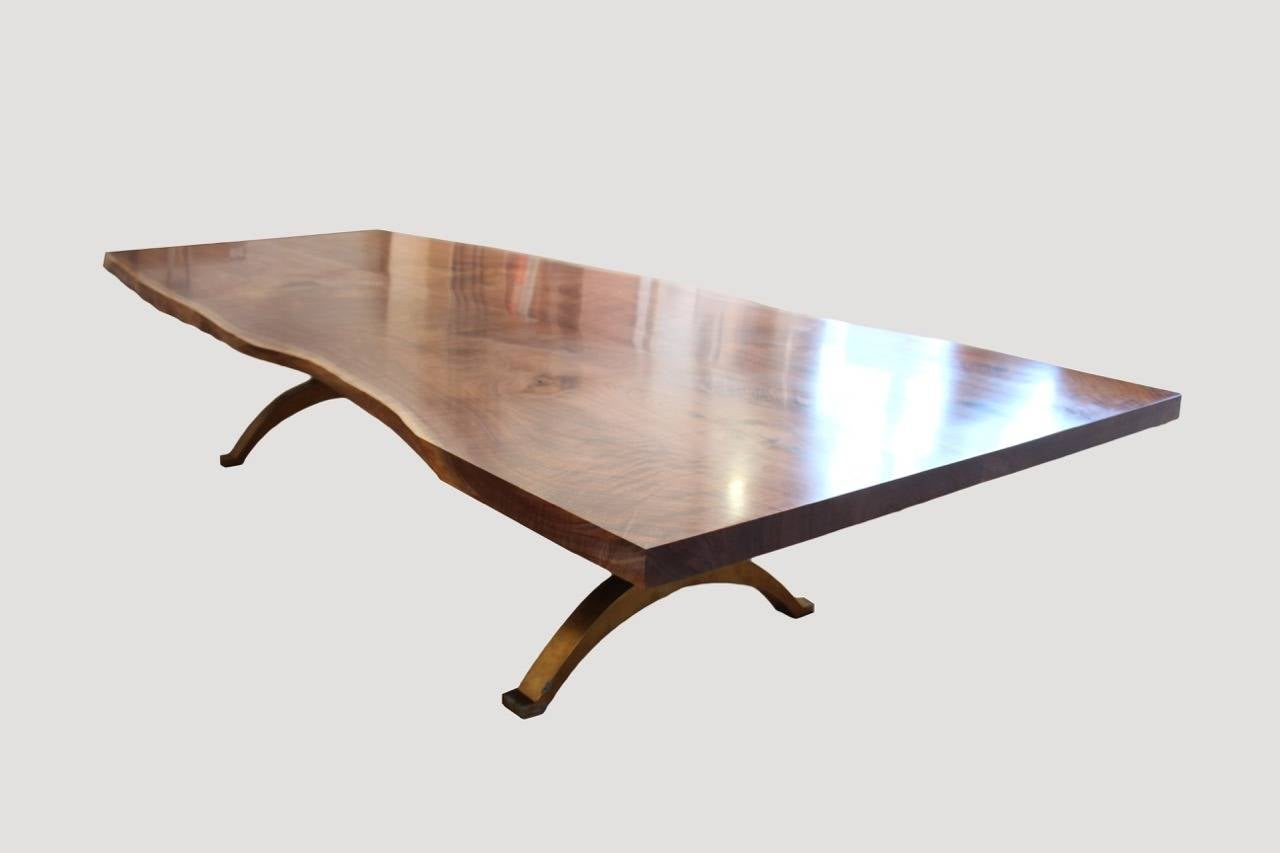 Hand made live edge walnut dining table with a bronze base. The price shown reflects a 120