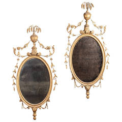 Pair of Carved Neoclassical Giltwood Oval Mirrors