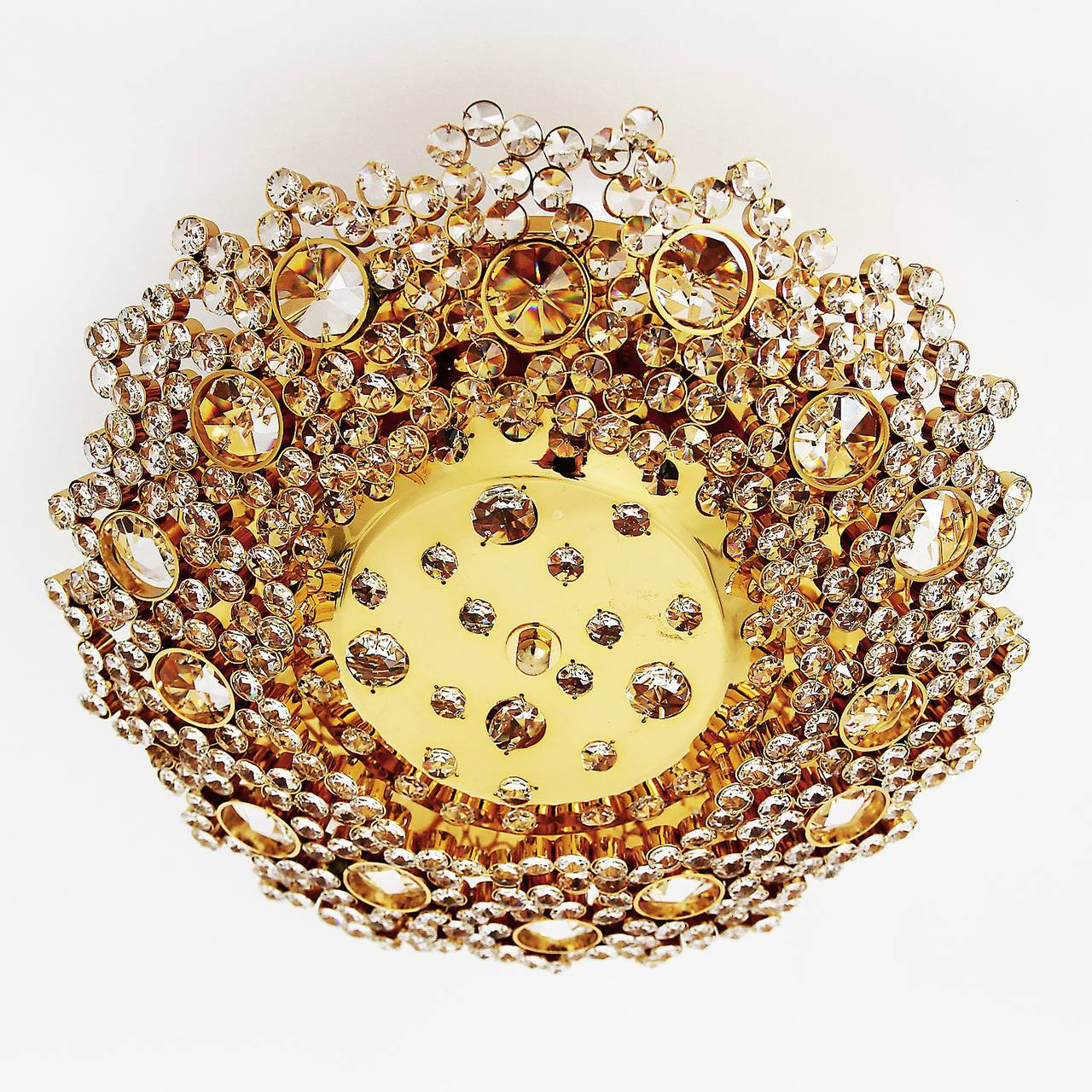 A very beautiful and high quality gold plated brass flush mount by Palwa (Palme & Walter), Germany, manufactured in Mid-Century, circa 1960. A gilt frame is made of hundreds of gilt brass rings which hold cut glass crystals in different sizes. A