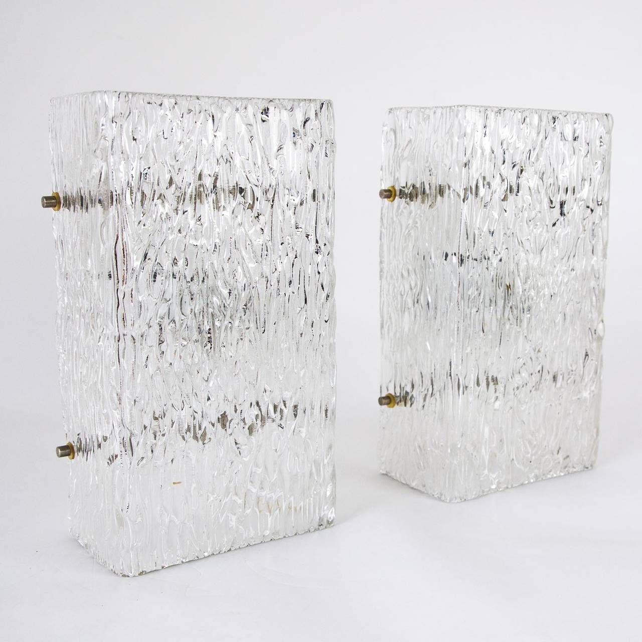 Beautiful pair of large 1950s glass sconces or wall lamps by J.T. Kalmar, Vienna, Austria. Thick textured glass creates a fantastic light effect. The chrome bolts can be replaced with brass ones if required.