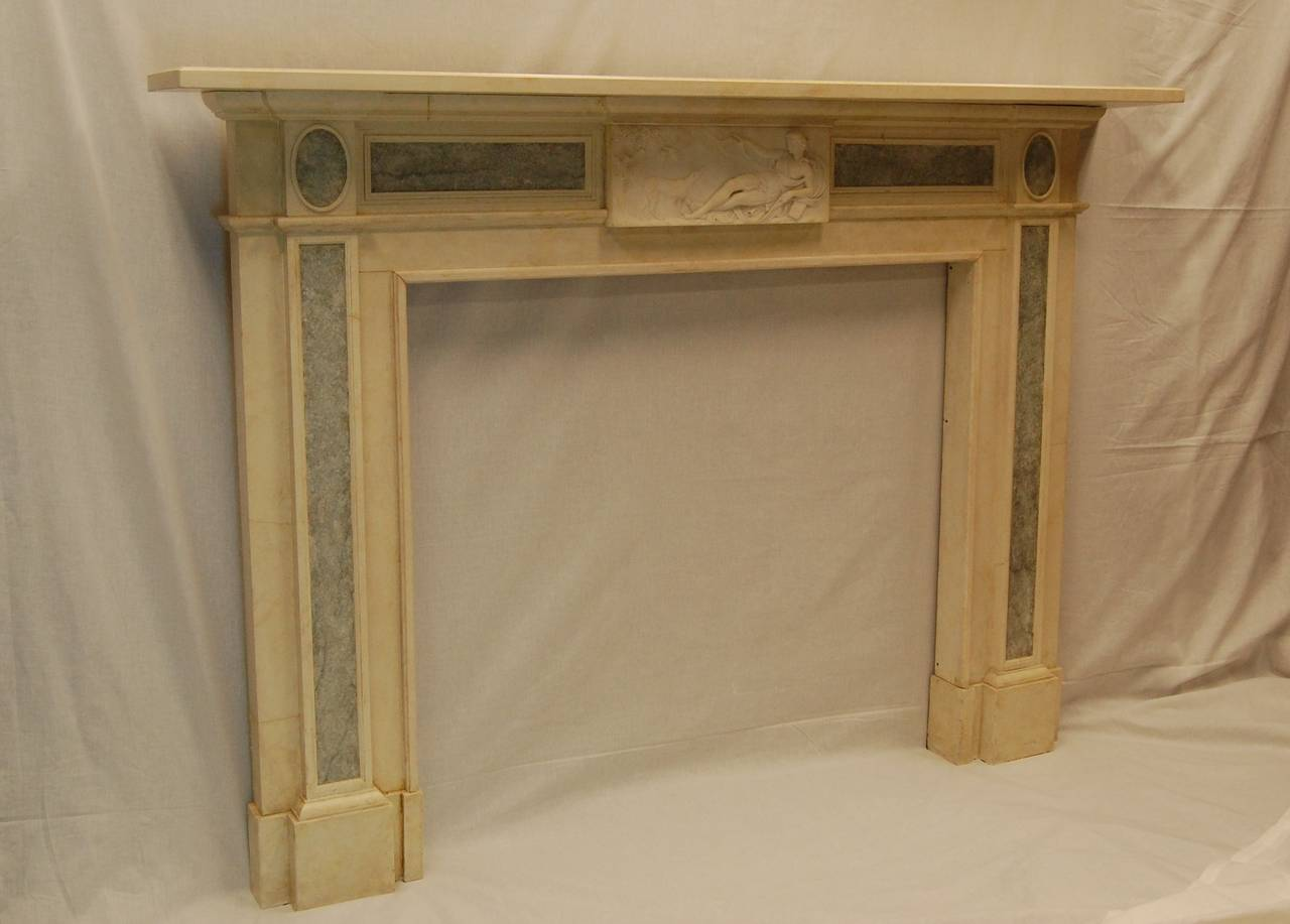 Repro faux marble mantel with antique carved marble plaque for Faux marble fireplace mantels
