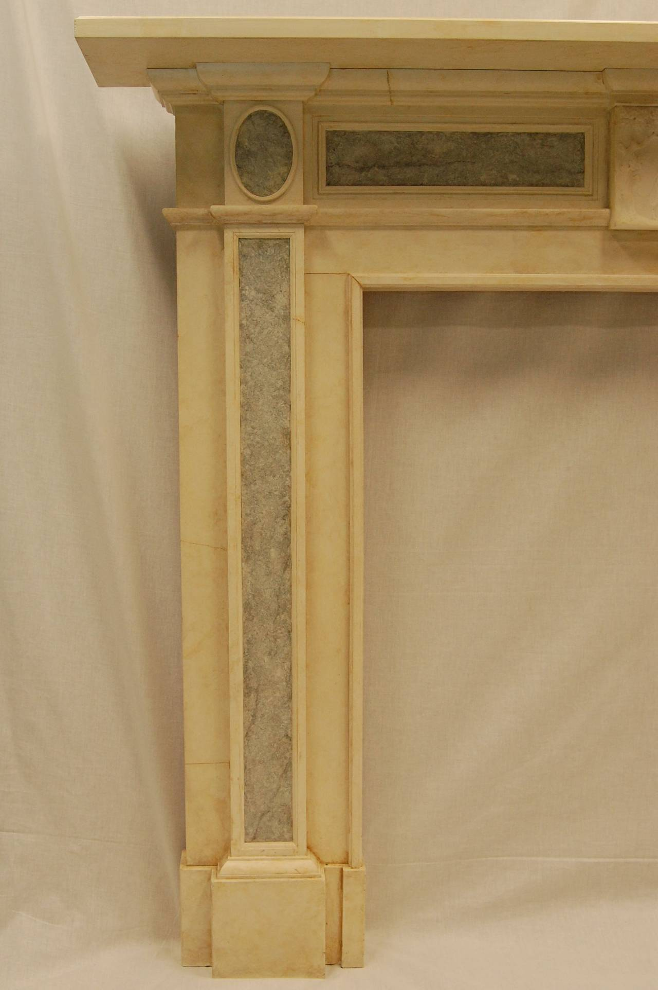 repro faux marble mantel with antique carved marble plaque