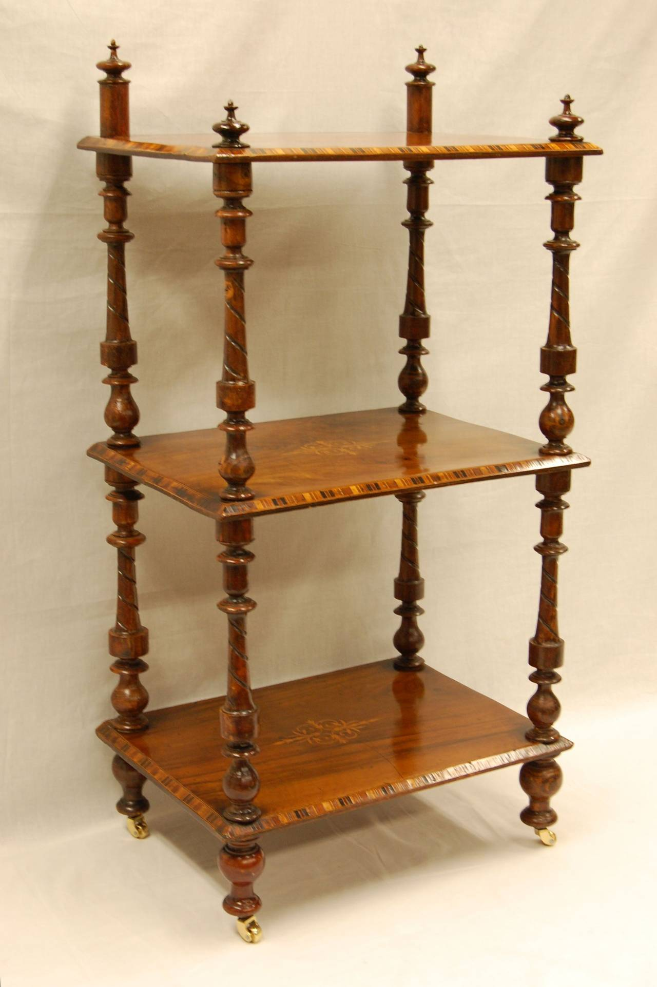 Early 19th century rosewood book stand with satinwood inlay, fancy turned posts and original finials. Excellent and tight condition. Possibly English or Italian.