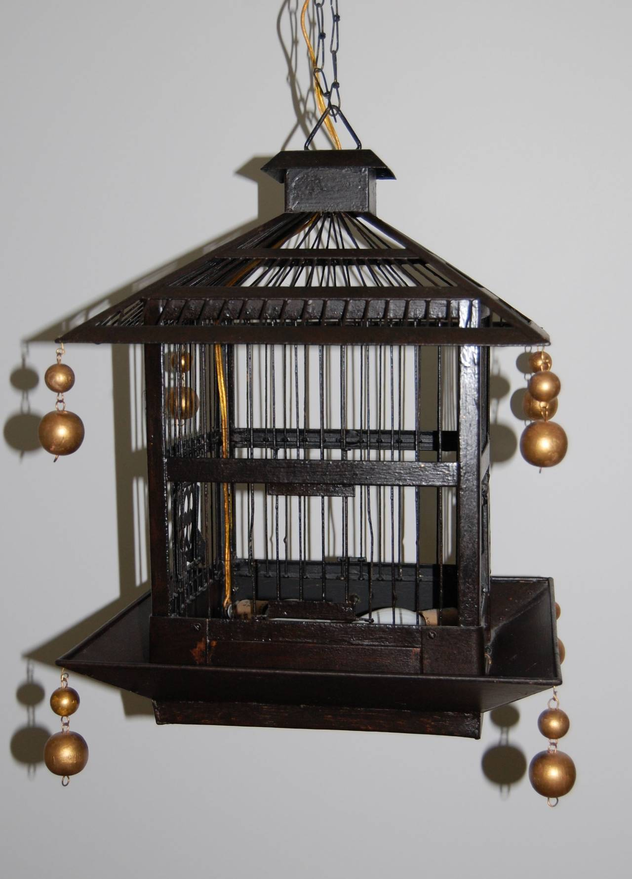 this 1920s birdcage hanging light fixture is no longer available