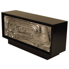 Striking Ebonized Sideboard with Silver Leaf, Sculptural Relief Front