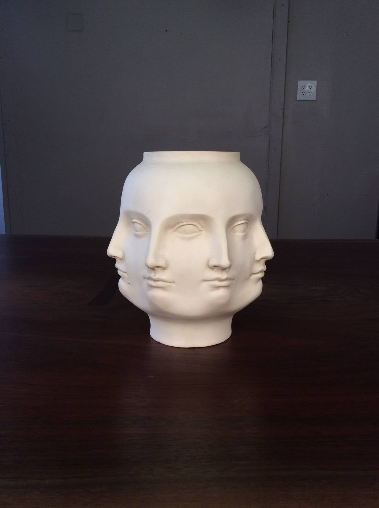 Surrealist infinite face vase in a matte bisque glaze 2005 at 1stdibs surrealist infinite face vase in a matte bisque glaze fantastic decorative vase with a repeating reviewsmspy