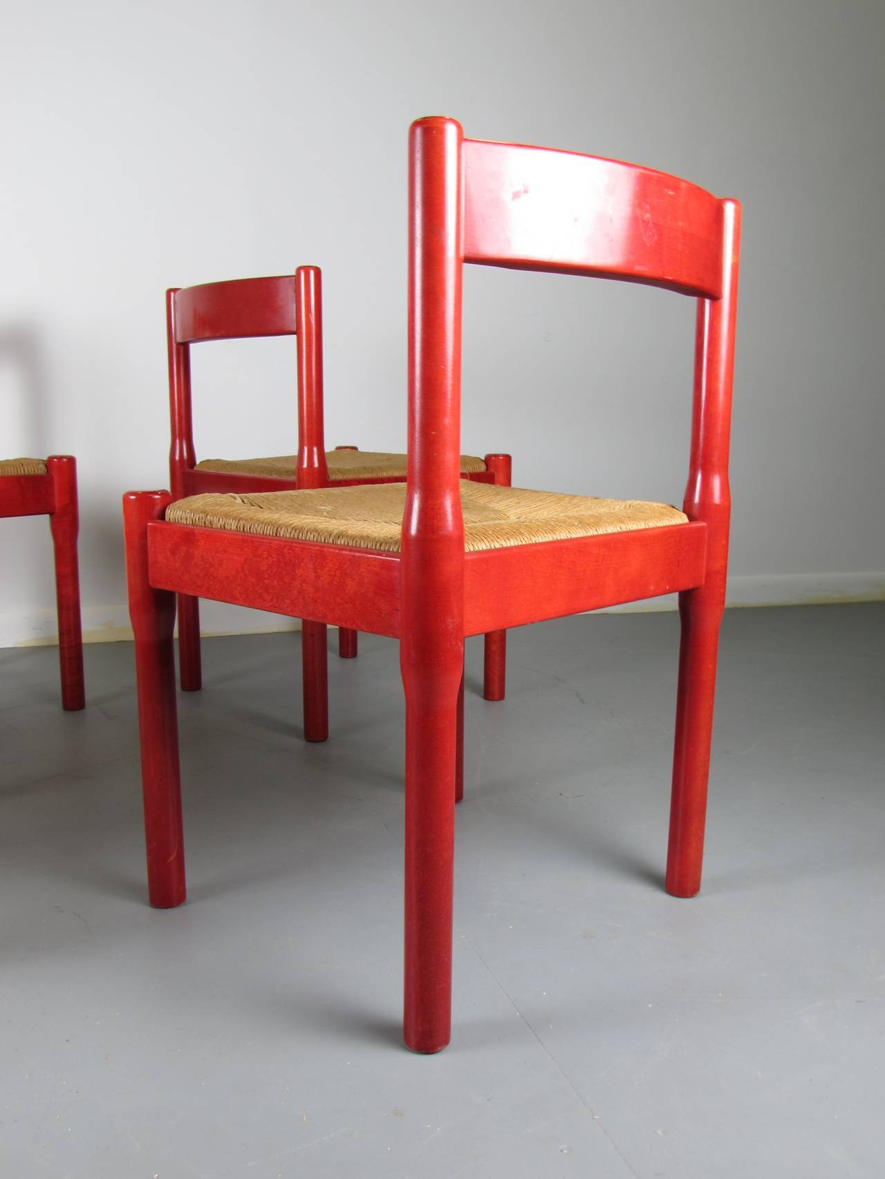 Joyful Set of Rare Red Carimate Dining Chairs by Vico Magistretti