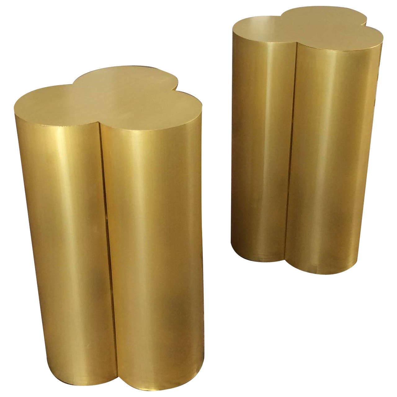 this custom trefoil dining table pedestal bases in polished brass is