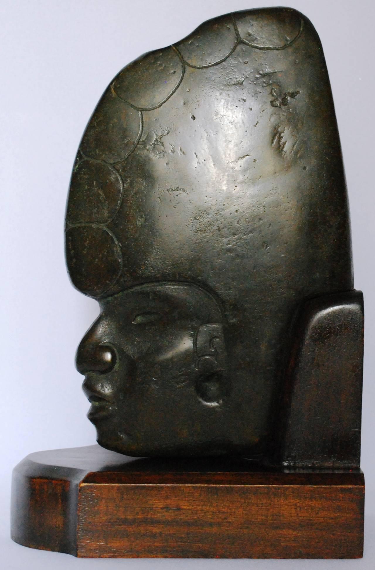 Cast bronze Mesoamerican sculpture. Vintage bronze casting of Mesoamerican stone hacha on original custom mahogany base. Dimension: 13