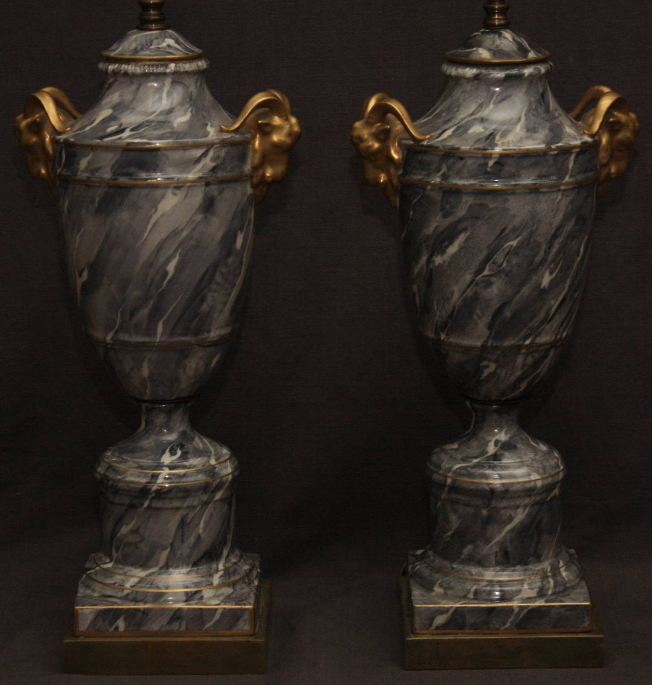 Pair of grey marbleized urn lamps. Pair of large vintage grey marbleized and gilt, Paris porcelain urn-form lamps with ram's head handles, France, 20th century.