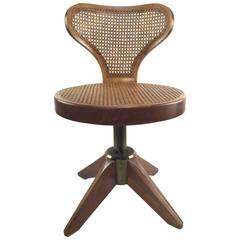 Striking Caned Swivel Chair on Splayed Legs