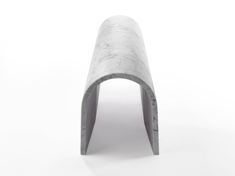 """The curved form of Galleria, a special edition piece designed for Salvatori by Ron Gilad, seemingly defies logic, begging the question """"But how do you bend stone"""".  It is beautiful simply as an objet d'arte or can also be used as a bench"""