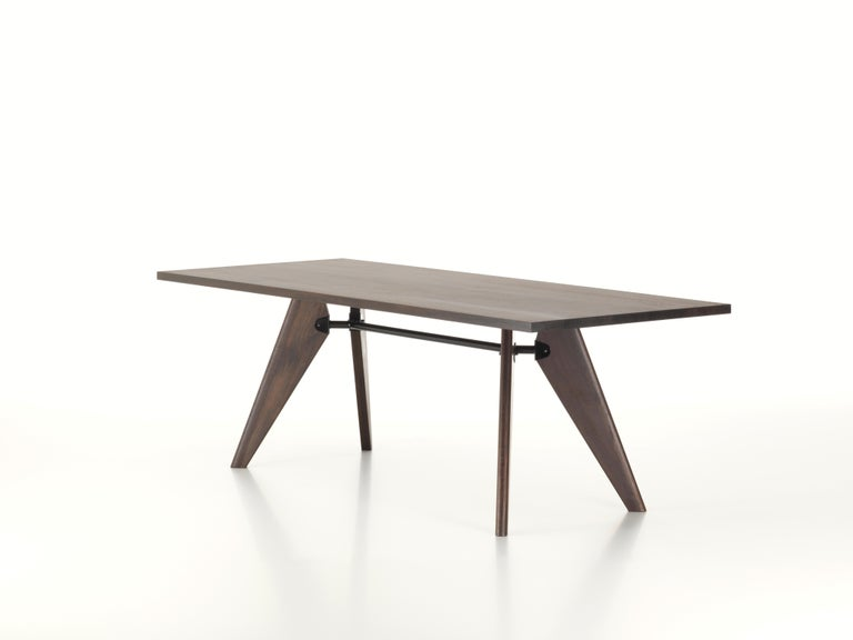 These items are currently only available in the United States.  Jean Prouvé developed table Solvay during the Second World War and due to the scarcity of metal at that time, he designed the elegant piece with wooden legs. The solid wood components