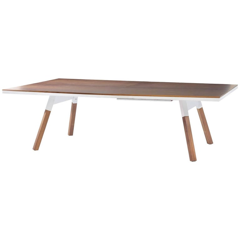 It's a piece of fine furniture and a ping-pong table. Standard sized, with a wood veneer surface and solid wood legs, a design, and a structure that gives it full playability. When not being used for play, it's also a large dining table, a