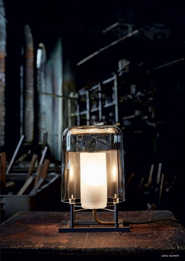 Lamp shade only for clear mouth blown Murano glass table lamp. Anthracite painted iron and natural brass designed in 1984 by Carlo Moretti and Paolo Martinuzzi.   60 watt incandescent bulb, 42 watt ecolamp socket E27.   Carlo Moretti: An