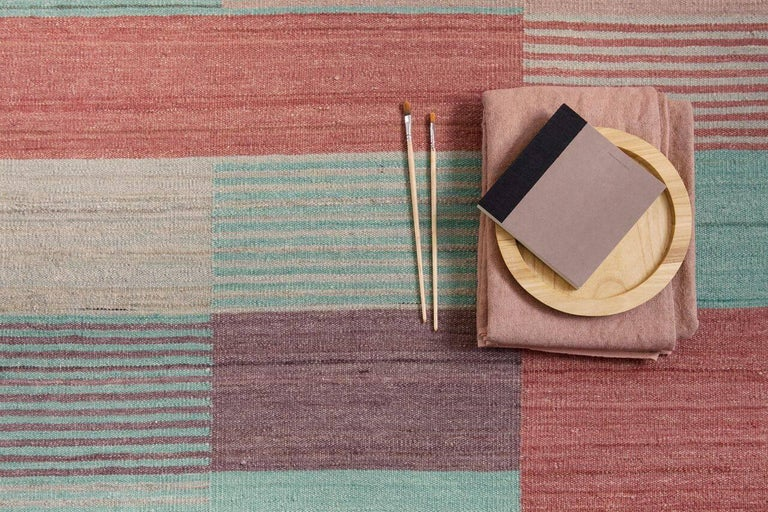 A slim, handwoven Kilim, Blend rug applies the basic rules of color theory, with three available models in which hue, luminosity, and saturation vary.  Blend plays with the visual perception of colours. Solid surfaces interact with surfaces that
