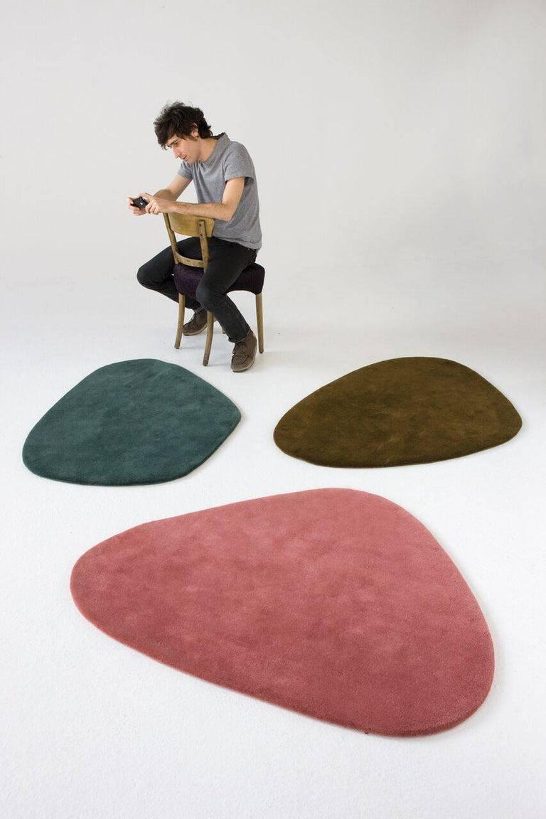 Inspired by Alexander Calder's famous mobiles, these irregular wool rugs are conceived to live together, forming attractive combinations.  An offshoot of the Zoom collection, there are three models in two colors that offer dynamic combinations