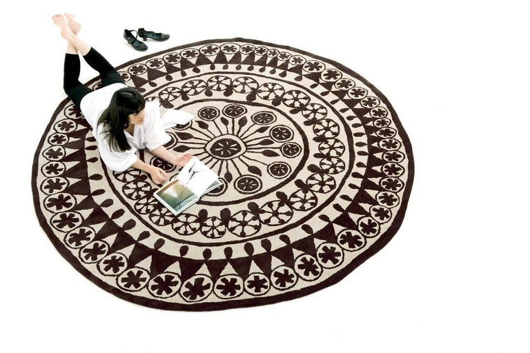A Rangoli is a Hindu floral design with a long historic tradition. Placed on the floor at the entrance of houses or buildings as a welcome symbol, the Rangoli provides protection or offers good luck.  The pattern is normally composed of flower