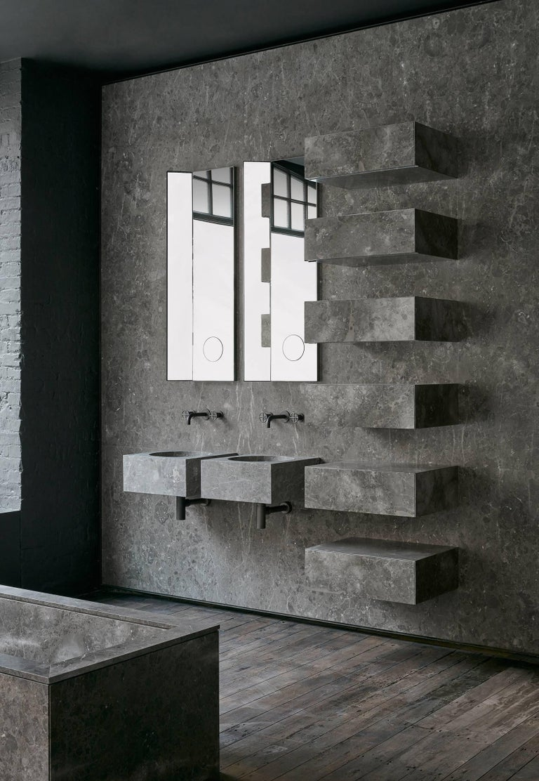 """Playing with the purity of geometric forms, the deceptively simple pieces exemplify  the  concept of """"artisan craft meets precision engineering"""". The uber-fine borders and delicate finishing of the basins in natural stone are offset by elegantly"""