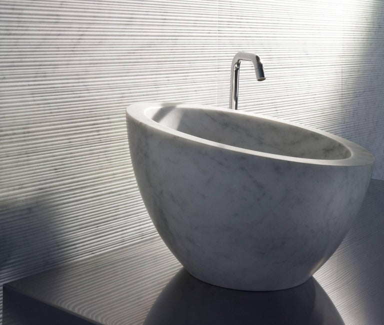 "A stunning deep vessel basin in beautiful natural stone which can be placed on the surface of your choice, Uovo (which means ""egg"" in Italian) adds a distinctive yet classic touch to any bathroom.  Available in Bianco Carrara, Crema d'Orcia, Gris du"