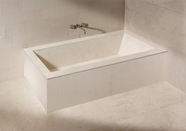 """Completely wrapped in natural stone, the Oyster bathtub could be described as a """"design your own tub"""".  With its beautifully simple structure, clean lines and 16 possible combinations of finish, it is the perfect starting point for a total look"""