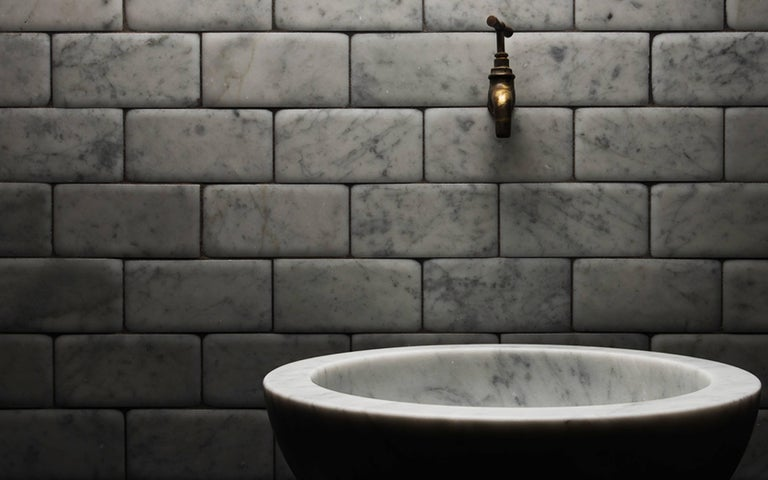A beautifully simple vessel basin in natural stone which can be placed on the surface of your choice, Zuppiera adds an elegant touch to any bathroom.  Available in Bianco Carrara, Crema d'Orcia, Gris du Marais, Light Travertine, Pietra d'Avola and