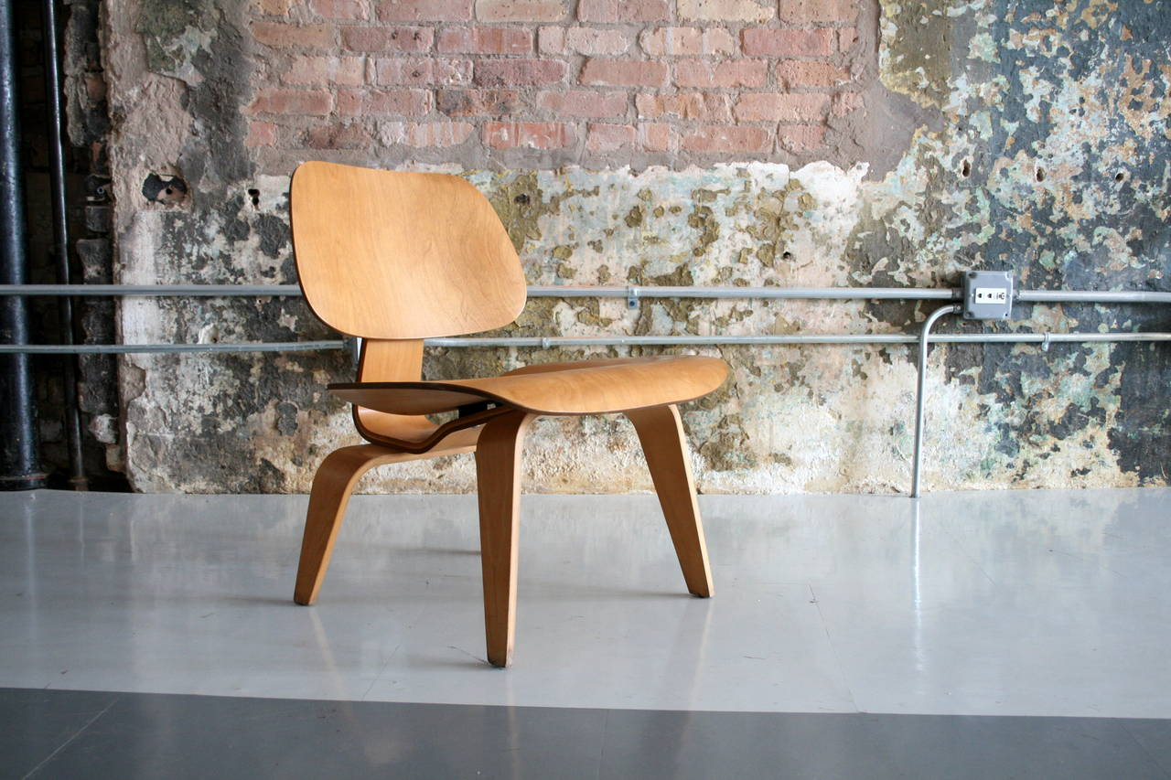 'Lounge Chair Wood' LCW by Charles Eames for Herman Miller,  USA 1950's. This is a beautiful example in original finish with a warm patina.
