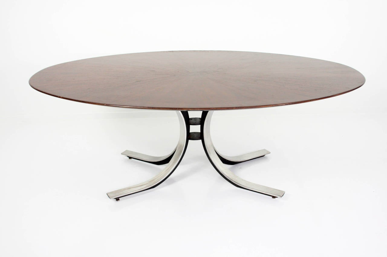 A gorgeous dining table by Borsani for Stow Davis. The top is walnut with a sunburst patterned veneer, atop Borsani's signature painted iron and chromed metal base. The table comfortably seats 6, a perfect size and shape that nicely balances