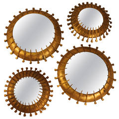 A Pair of Gilt Iron Small Brutalist Sunburst Mirrors