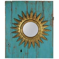 Giltwood Sunburst Mirror on a 19th Century Turquoise Door Wall Decoration
