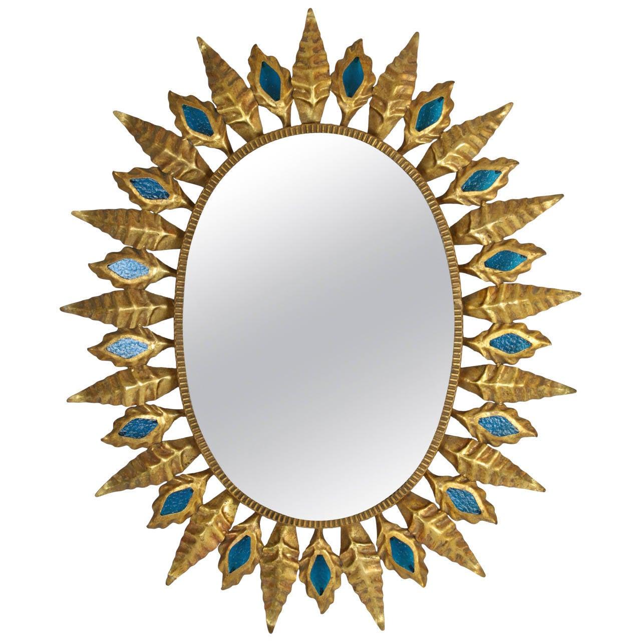 Gilt iron sunburst oval mirror with blue glasses at 1stdibs for Sunburst mirror