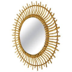 Spanish bamboo and rattan sunburst mirror with curved beams.